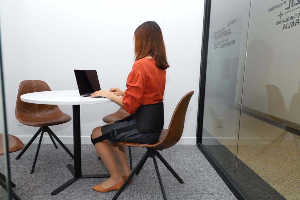 A women using the Renuback Posture Corrector